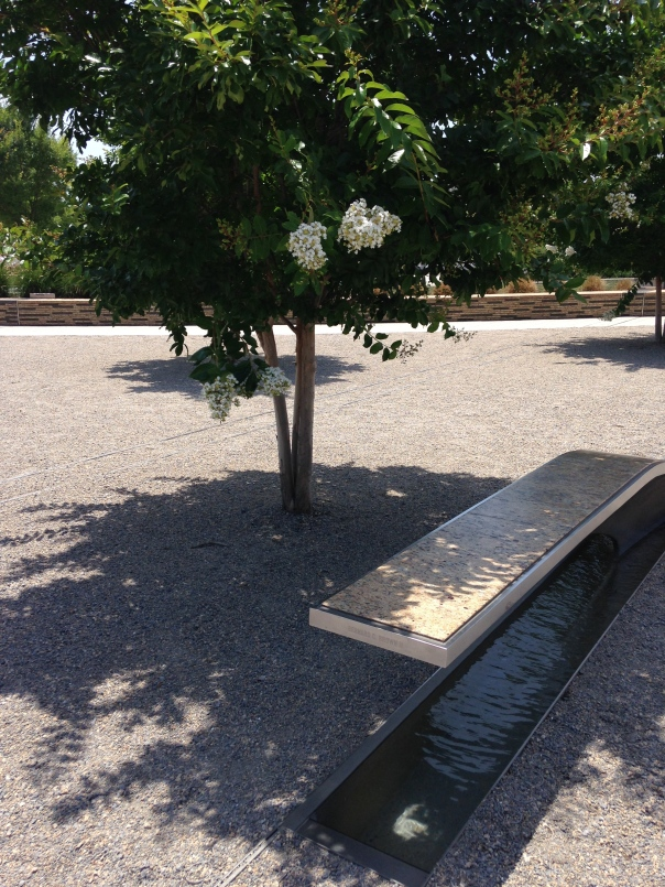 Each bench at the Pentagon Memorial has a name of a victim.  There are reflecting pools below each one.  How the seats are placed reflect how the victims were seated during the crash.